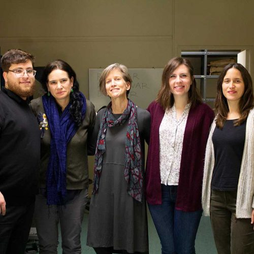 : Hayward (center) com worked with colleagues (from left to right) Benjamin Hernández Pacheco, Michelle Prain Brice, Tess Henthorne '16, Maria Paz Zegers Correa at the Digital Imaging Lab of the National Library of Chile in the summer of 2019.