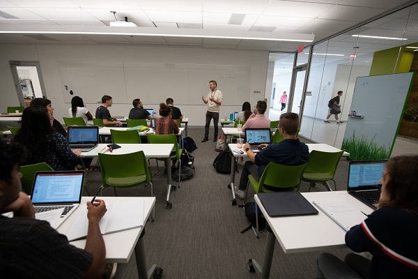 Professor Dean Fraga and students engage in lecture in a Williams classroom