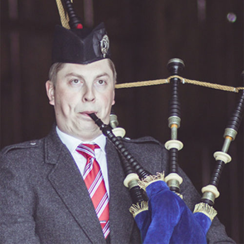 Palmer Shonk portrait playing bagpipes