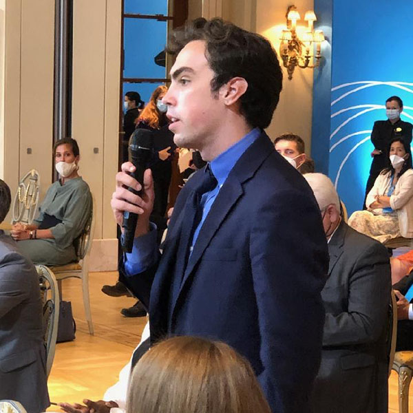 Adam Hinden, College of Wooster student, asks a question at a panel at the Athens Democracy Forum